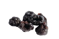 Group of dried black plums isolated Stock Photography