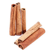 Group of dried cinnamon stics isolated on white background Royalty Free Stock Photos