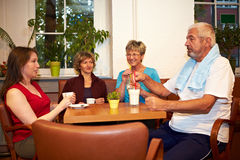 Group drinking coffee in gym Stock Image
