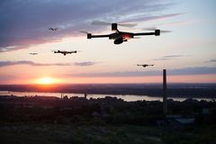 Group of drones above the city. Group of drones approaching the city royalty free stock image