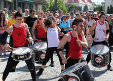 Group of drummers on pedestrian street Royalty Free Stock Images