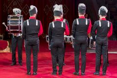 A group of drummers perform at a concert. drummers in the circus arena. stock photography