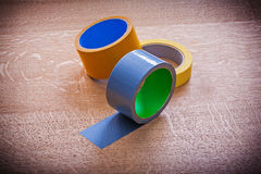 Group of duct tapes on vintage wood board Stock Photography