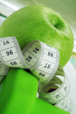 Group of Dumbbells and apples Stock Images