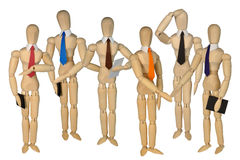 Group dummies - several men. Several mannequins - men in white collars and ties are next in various poses Royalty Free Stock Image