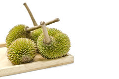 Group of Durian on plain wood Stock Image