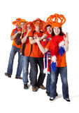 Group of Dutch soccer fans making polonaise over white backgroun Royalty Free Stock Images