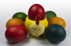 Group of Easter Eggs with Chick Egg holder. Closeup on the Easter Eggs with one placed in the Chick Egg holder holding Red Easter Egg Royalty Free Stock Photos