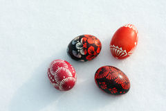 Group of Easter eggs on snow Royalty Free Stock Image