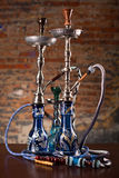 Group of eastern hookahs on table. In studio close up Stock Photos