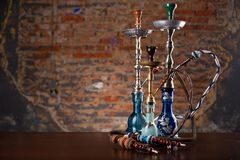 Group of eastern hookahs on table. In studio close up Stock Image