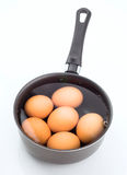 Group of eggs immersed in water Royalty Free Stock Photo