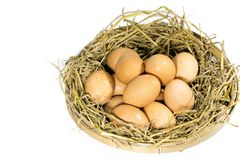 Group of eggs with straw. In a bamboo basket isolated on white background Stock Image