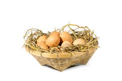 Group of eggs with straw. In a bamboo basket isolated on white background Stock Photo