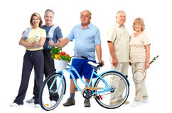 Group of elderly fitness people with bicycle. Royalty Free Stock Images