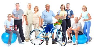 Group of elderly fitness people with bicycle. Group of elderly fitness people with bicycle isolated white background Royalty Free Stock Photos