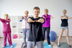 Group of elderly people doing exercises Royalty Free Stock Images