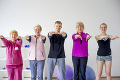 Group of elderly people doing exercises Stock Images