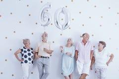 Elderly people during birthday meeting. Group of elderly people have fun together during a birthday meeting Royalty Free Stock Images