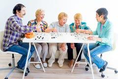 Seniors playing bingo. Group of elderly people playing bingo tigether Royalty Free Stock Images