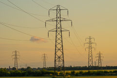Group of electricity pylons Stock Photos