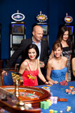 Group of elegant people playing roulette Stock Photo