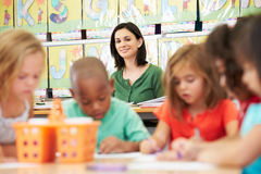 Group Of Elementary Age Children In Art Class With Teacher Stock Image
