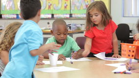 Group Of Elementary Age Children Using Coloring Pens stock footage