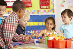 Group Of Elementary Age Schoolchildren In Art Class Stock Image