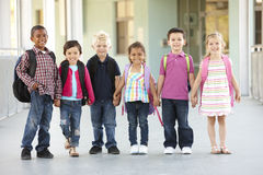 Group Of Elementary Age Schoolchildren Standing Outside Stock Image