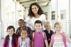 Group Of Elementary Age Schoolchildren Standing Outside With Teacher Stock Image