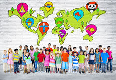 Group Of Elementary Aged Children. Standing in front of a wall of world cartography Stock Photos