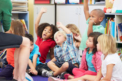 Group of Elementary Pupils In Classroom Answering Question Stock Images