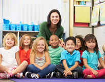 Group of Elementary Pupils In Classroom With Teacher Royalty Free Stock Images