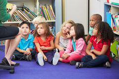 Group of Elementary Pupils In Classroom Working With Teacher Royalty Free Stock Photos