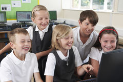 Group Of Elementary Pupils In Computer Class Royalty Free Stock Photos
