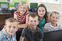 Group Of Elementary Pupils In Computer Class. Portrait Of Group Of Elementary Pupils In Computer Class Stock Photos