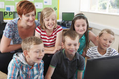 Group Of Elementary Pupils In Computer Class With Teacher Royalty Free Stock Photography