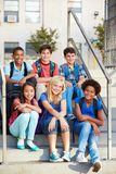 Group of Elementary Pupils Outside Classroom. Sat on the stairs Royalty Free Stock Photography