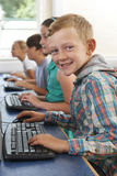 Group Of Elementary School Children In Computer Class Stock Photography
