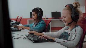 Mixed Racial group Of Elementary School Children In Computer Class. Group Of Elementary School Children In Computer Class stock footage