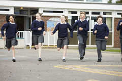 Group Of Elementary School Pupils Running In Playground Royalty Free Stock Photo