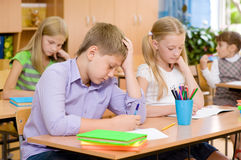 Group of elementary school pupils takes the test in class Stock Photos