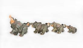 Group of elephants. Ceramic on a white background Stock Photo