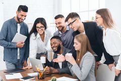 Group of employees working on laptop at meeting stock images