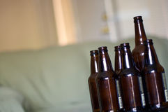 Group of empty beer bottles on a table. Angled Royalty Free Stock Image