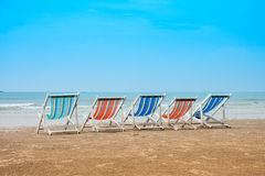 Group of empty deck chairs on sea beach. Vacation with friends concept Royalty Free Stock Photography