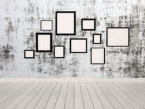 Group of empty picture frames hanging on a wall Stock Photos