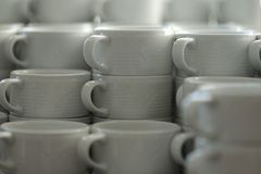 Group of empty white ceramic cups for coffee or tea in a hotel royalty free stock images