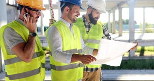Group of engineering team had meeting at working site stock image